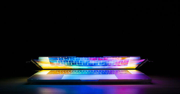 Laptop open in dark